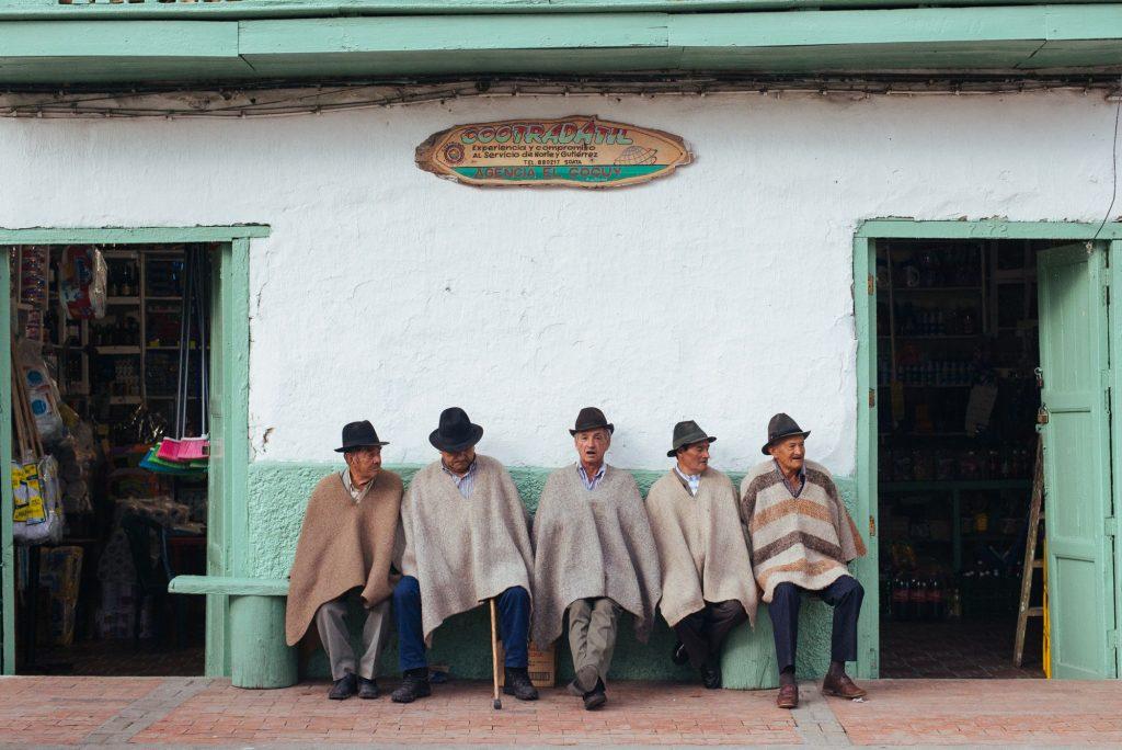 South American men sitting on bench